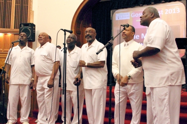 Members of the Men In White Choir performing at Community Missions' 2013 Gospel Fest Concert.
